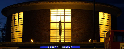 Arnos Grove underground station by night.