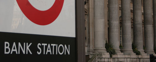 Bank station sign, with the Bank of England in the background.