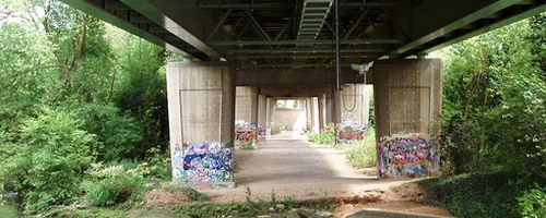 The space under the M4, all graffiti and trees.