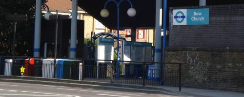 The outside of Bow Church station, with sign.