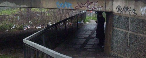 Someone standing under a flyover near Brent Cross.